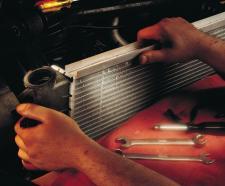replace radiator to repair coolant leak